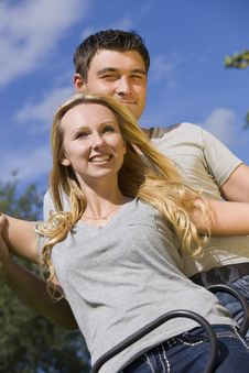 Free Young Couple On A Swing Stock Photography - 20750632