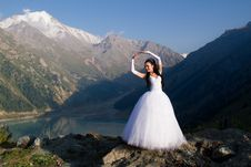Free Romantic Girl In A Wedding Dress On A White Nature Royalty Free Stock Images - 20752009