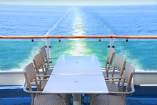 Dining Table And Chairs With Ocean View Stock Photography