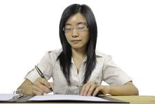 Free Chinese Businesswoman, Sitting At Desk Writing Royalty Free Stock Photography - 20756307