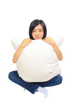 Young Chinese Woman Hugging A Pillow Royalty Free Stock Photo