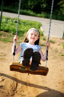 Free Happy Child Girl Is Swinging In The Playground Stock Images - 20757814