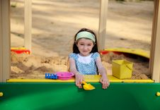 Happy Child Girl Is Playing In A Sandbox Royalty Free Stock Image