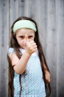 Free Long-haired Child Girl Poses With Thumbs Up Royalty Free Stock Image - 20757826