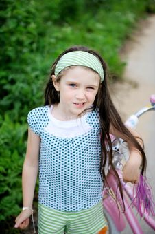 Free Long-haired Child Girl Poses With Pink Bycicle Royalty Free Stock Photos - 20757828