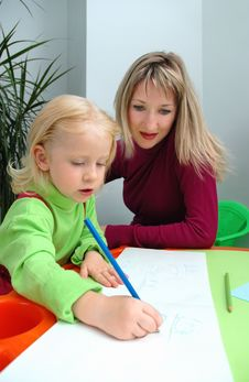 Free Little Girl With Mother Draws Pencil Stock Image - 20761781