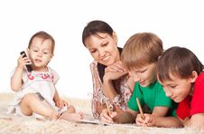 Free Family Of A Four On Carpet Royalty Free Stock Image - 20762216