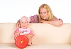 Free Mom Sits With Her Baby Royalty Free Stock Photo - 20763035