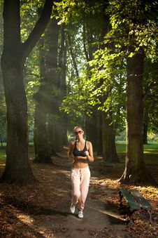 Free Woman Jogging In The Park Royalty Free Stock Photo - 20763125