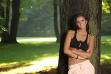 Free Attractive Young Woman Standing By The Tree Stock Photo - 20763200