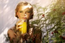 Woman With A Glass Of Orange Juice Stock Images