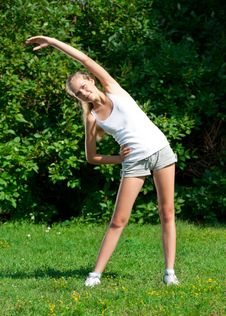 Free Girl Doing Stretching Exercise Royalty Free Stock Images - 20764799