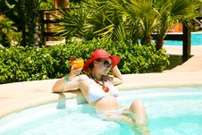Beautiful Woman In Swimming Pool With Cocktail Royalty Free Stock Image