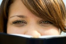 The Girl Looks Out Because Of The Book Close Up Royalty Free Stock Photo