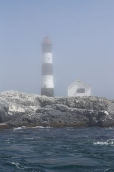 Lighthouse In The Mist Stock Images
