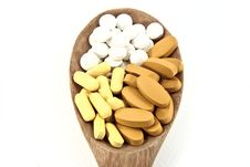 Free Wooden Ladle With Pills Royalty Free Stock Photo - 20773575