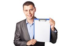 Free Smiling Young Businessman Holding Clipboard Royalty Free Stock Image - 20774446