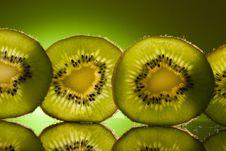Green Kiwi In Row Stock Photos