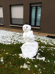 Free Snowman On The Green Grass In The Yard Of The House  Ljubljana  Slovenia. Stock Photos - 207785483
