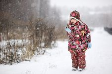 Free Child Girl In Colorful Snowsiut Plays In Snow Stock Images - 20781414