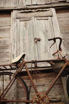 Old Bicycle And Old Wood House Royalty Free Stock Photos