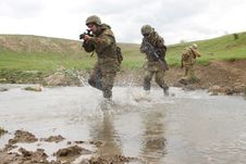 Free Soldiers Running Across The Water Royalty Free Stock Photography - 20786137