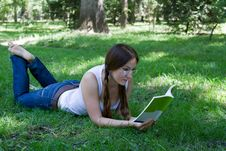 Student Girl Reading A Book On The Grass Stock Photography