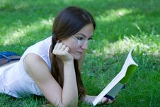 Business Woman Reading A Book On The Grass Stock Image