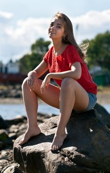 Free Girl In A Red Sweater Sits On A Rock Royalty Free Stock Photography - 20787927