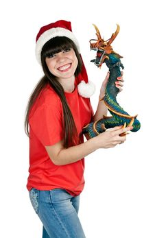 Free Girl In Santa Hat With A Decorative Wooden Dragon Stock Photo - 20788180