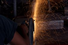 Free Cutting Steel With A Small Grinder Stock Photos - 20798343