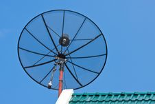 Satellite Dish  On Green Roof Tile Stock Image