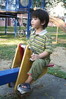 Free Boy On Seesaw Royalty Free Stock Photo - 2080305