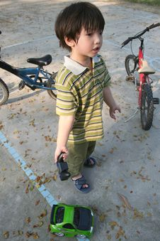 Free Boy & Remote Control Car Royalty Free Stock Photo - 2080485