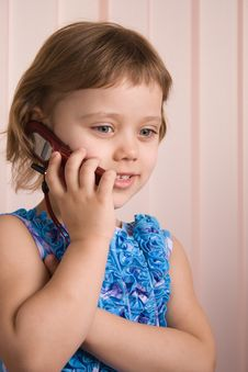 Free Little Girl Talking At Phone Royalty Free Stock Photography - 2085497