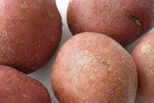 Red Potatos  On The Background Clouseup Royalty Free Stock Images
