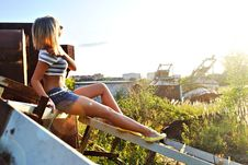 Free Young Girl In Blue Shorts On Metal Constr Stock Photography - 20804032