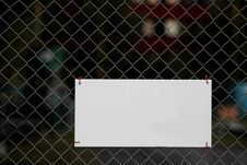 Blank Sign On Fence Royalty Free Stock Image