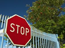 Stop Sign On The Old Gate Stock Images