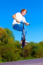 Free Boy Jumping With His Scooter Royalty Free Stock Photography - 20819557