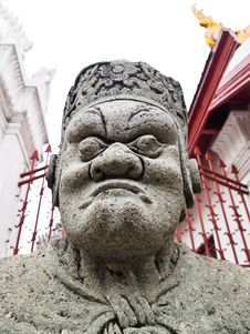 Stone Giant Guard At Wat Arun, Bangkok Stock Photo