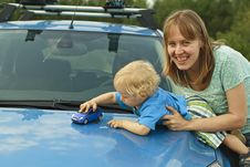 Playing Car Toy On Hood Stock Images