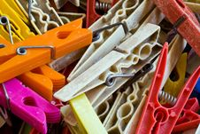 Plastic And Wood Pegs Stock Photos