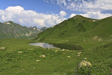 Free Small Mountain Lake Under Cloudy Sky Royalty Free Stock Photos - 20817458