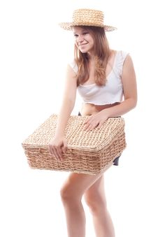 A Girl In A Straw Hat With A Straw Suitcase Stock Image