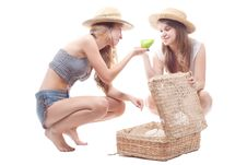 Two Girls In Straw Hats With A Straw Suitcase Stock Photos