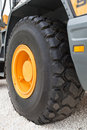 Free Black Wheel With Yellow Disk Of Front Loader Stock Images - 20827304