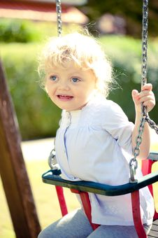 Free Little Girl On A Swing Royalty Free Stock Images - 20820169