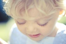 Free Little Girl Looking Down Stock Photos - 20820193