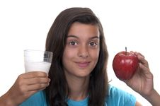 Free Teenage Girl With Red Apple And A Glass Of Milk Royalty Free Stock Photos - 20820398